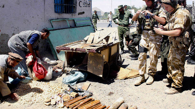 Explosives that were hidden in a handcart lay on the ground in Kabul on July 3, 2004. In an effort to foil the country's first presidential election, the Taliban swapped broader offensives for homemade bombs and guerrilla warfare techniques.