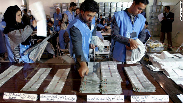 Election officials count ballots in Kabul, Afghanistan, on October 14, 2004. The country's first democratic election was held on October 9, and Hamid Karzai was sworn in as president in December.