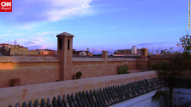 "Joanne Huang shared a lovely sunset shot from the rooftop of Hotel Les Jardins de La Koutoubia. ""Morocco is a very historic and magical place that has a profound respect for its traditions and culture, while hints of modernity can be picked up here and there."""