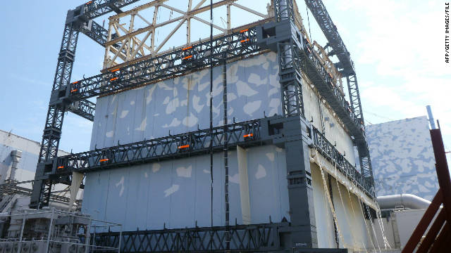 Fukushima Daiichi nuclear power plant Unit 1 reactor building is covered by a steel frame as a safety measure.