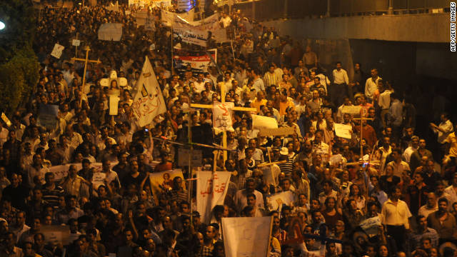 Thousands of protesters march in Cairo on Sunday, more than a week after the burning of a Coptic Christian church.