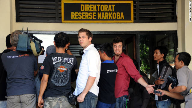 Journalists gather at a police station in Bali where a 14-year-old Australian boy was reportedly held for possesing cannabis.