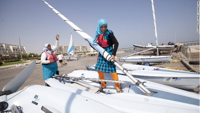 Trainee female sailors prepare their boats for sailing during a training session in Massanah in Oman.