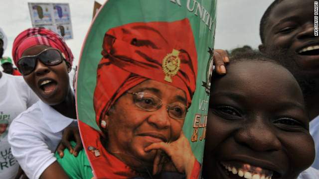 Supporters of Liberia's outgoing President Ellen Johnson Sirleaf and presidential candidate, cheer on a street of Monrovia