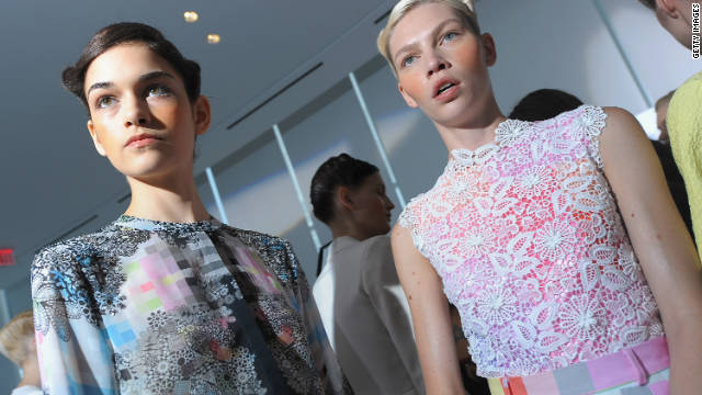 Models prepare backstage at the Preen by Thornton Bregazzi Spring 2012 show. Fashion-watchers say soft pastel color palettes will dominate Spring 2012.