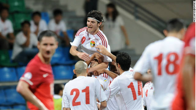 Delighted Jordan players celebrate a goal in their 3-0 win in Singapore