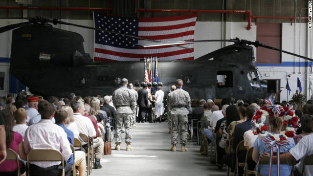 A memorial service recognizes the air crew killed August 6 when their Chinook helicopter crashed in Afghanistan.