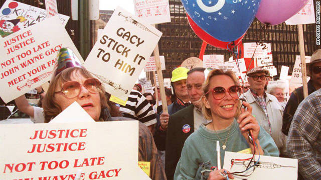 Demonstrators in Chicago rally ahead of the execution of serial killer John Wayne Gacy in May 1994.