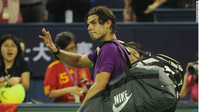 Rafael Nadal waves goodbye to the crowd after exiting the Shanghai Masters to Florian Mayer