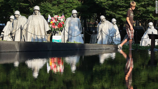 The Korean War Veterans Memorial honors all of the American services and includes statues of figures in uniforms representing each branch.