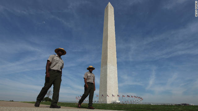 The Washington Monument varies in color because sections of it were started at different times -- in 1854 and later in 1879. The two sections used marble from different quarries, and weathering and erosion have made the difference more noticeable. The momument has been closed temporarily since the August 23 earthquake.
