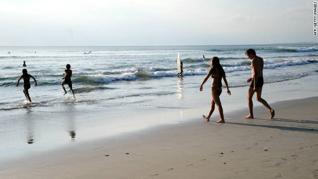 Tourists enjoy Kuta beach on Bali on October 10, 2011. No tsunami alert was issued after the earthquake.