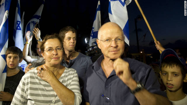 Aviva and Noam Shalit are surrounded by supporters at their home after news of the deal that would free their son.