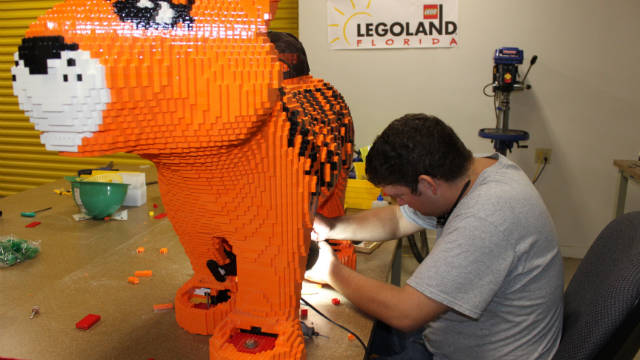 Legoland figures are designed by computers, but each figure is hand-built using the same Lego parts available to the public.