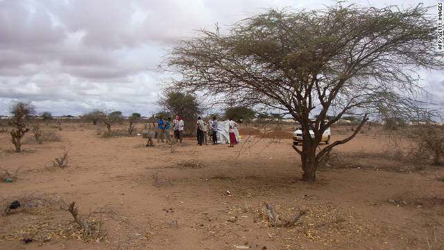 Somali refugees gather at the spot where two Spanish aid workers were kidnapped from the Dadaab refugee camp in Kenya.