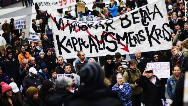 "Protesters hold a banner that says in Swedish, ""We refuse to pay the crisis of capitalism,"" as they take part in the Occupy Stockholm demonstration on Saturday."