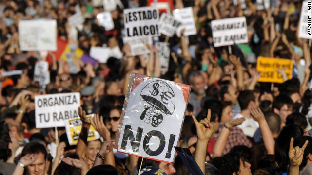 More than 10,000 protesters retake the streets Saturday, in Madrid, where five months ago the &quot;May 15 Movement&quot; began. Some demonstrators said they felt Spain's protest had gone global and that the world had joined their movement.