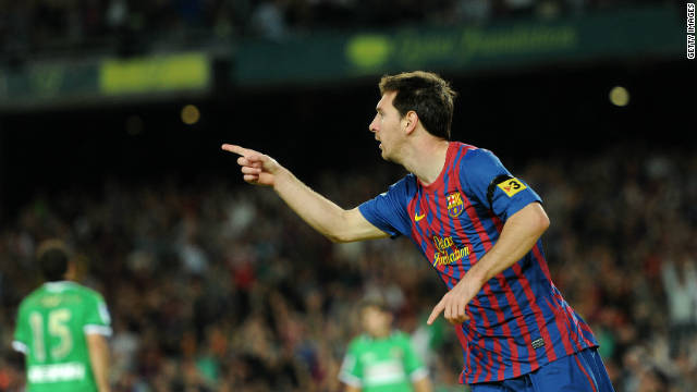 Lionel Messi celebrates yet another goal in the 3-0 win over Racing Santander.