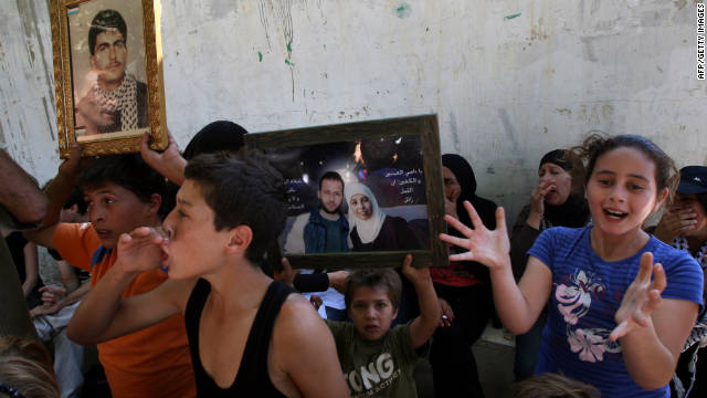 Palestinian children cheer for the release of Ahlam Tamimi (shown in photo), imprisoned for a 2001 bombing that killed 16.