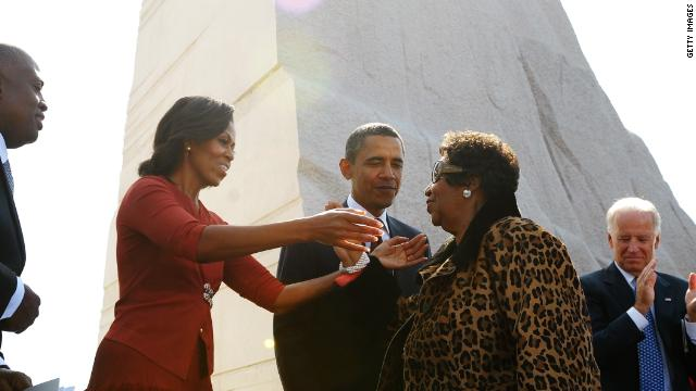 "First lady Michelle Obama, left, reaches out to embrace singer Aretha Franklin as President Obama , Vice President Joe Biden, and Jill Biden look on after Franklin performed at the ceremony. Franklin sang ""Take My Hand, Precious Lord,"" a song she said King often requested."