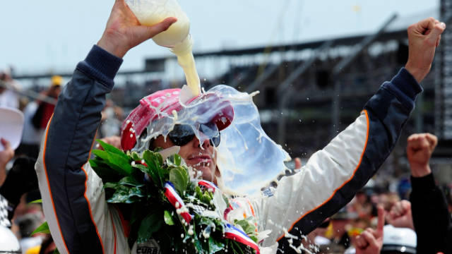 Wheldon celebrates his Indianapolis 500 victory on May 29 with the traditional bottle of milk. Unlike previous winners, he chose to bathe in it.