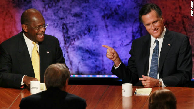 Mitt Romney, right, and Herman Cain participate in the Republican presidential debate on October 11.