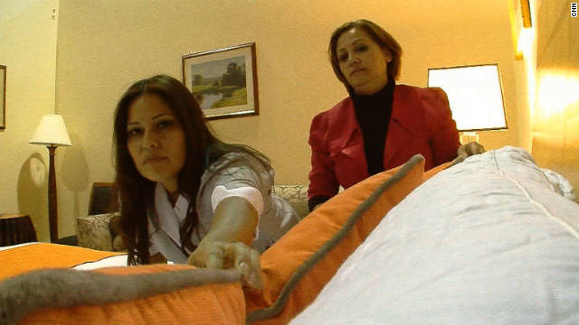 Mirna Castaneda, left, trains for her new job at a Las Vegas hotel as a member of the Culinary Workers Union.