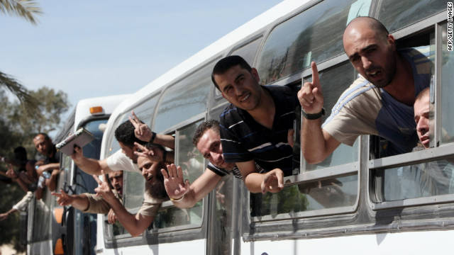 Palestinian prisoners cross to the southern Gaza Strip after being released from Israeli prisons.