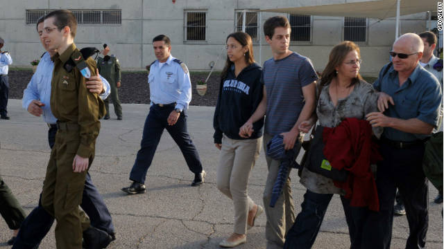 Freed Israeli soldier Gilad Shalit is followed by his family after meeting them for the first time in five years at Tel Nof Airbase.
