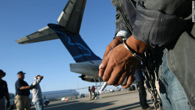 An undocumented Guatemalan charged as a criminal prepares to board a deportation flight in Mesa, Arizona, this summer.