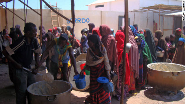 Displaced Somali women line up for food rations Monday at a feeding center in southern Somalia.