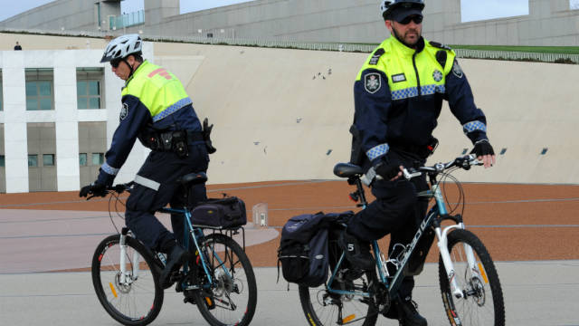 Several police forces around the world use bicycles as a means of transportation. In this instance, Australian Federal Police on mountain bikes patrol the courtyard of Parliament House in Canberra.