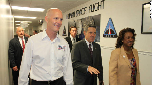 Florida Gov. Rick Scott, left, tours NASA's Kennedy Space Center, where he addressed the center's future