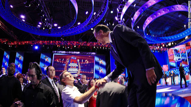 Mitt Romney, shown at a CNN debate, contends the Massachusetts health care plan differs greatly from the Obama plan
