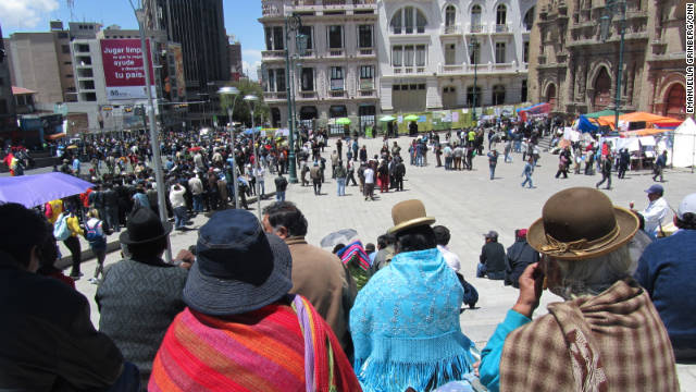 Residents of La Paz watch protesters in Plaza San Francisco demonstrate against the construction of a proposed road. The plaza is the city's biggest open public space.