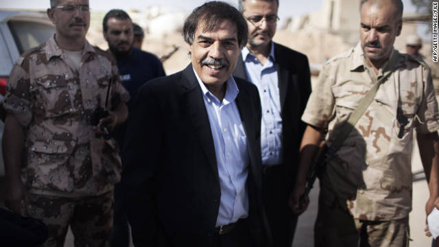 Ali Tarhouni, pictured in July, is Libya's oil and economy minister and one of the first senior officials of the NTC to arrive in Tripoli.