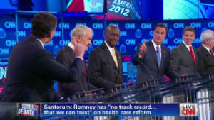 Romney, Santorum argue over health care