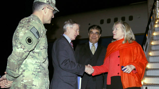 Ryan Crocker, U.S. ambassador to Afghanistan, greets Secretary of State Hillary Clinton upon her arrival in Kabul. 
