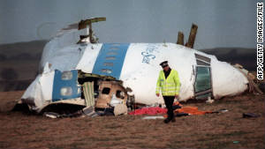 A policeman examines the site where a Boeing 747 crashed after exploding over Lockerbie, Scotland, in December 1988.