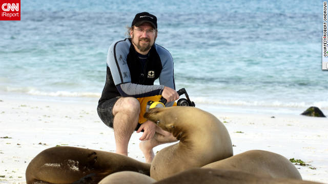 He was lucky to get this shot taken with a sea lion. &quot;I just came out of the water after doing some snorkeling and underwater photography, and found a few new friends sitting near my towel and gear.&quot;