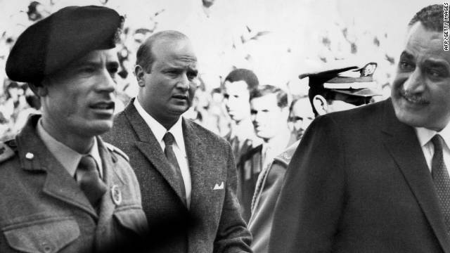 Moammar Gadhafi, left, arrives for an Arab Summit Conference in Rabat, Morocco, with Egyptian President Gamal Abdul Nasser in December 1969, months after taking control of Libya in a bloodless coup.
