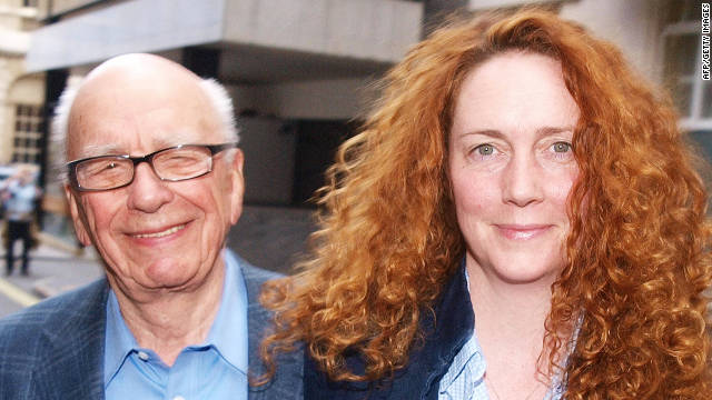 Rupert Murdoch and former NOTW editor Rebekah Brooks leave his London residence in July. 