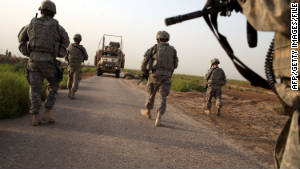 U.S. soldiers with the 3rd Armored Cavalry Regiment patrol Iskandariya, Iraq, on July 17, 2011.