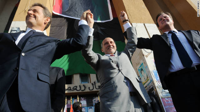 Nicolas Sarkozy, leader of Libya's interim government Mustafa Abdul-Jalil and David Cameron in Benghazi on September 15.