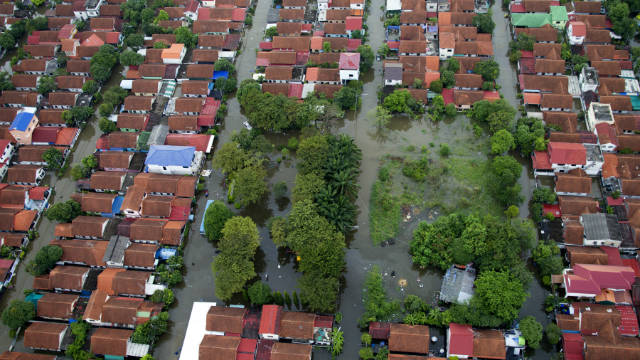 Flood waters surround houses October 20 in the neighboring provinces of Bangkok, Thailand.