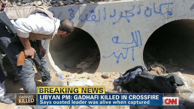 Gadhafi murió en un tiroteo después de su captura, dice el primer ministro libio