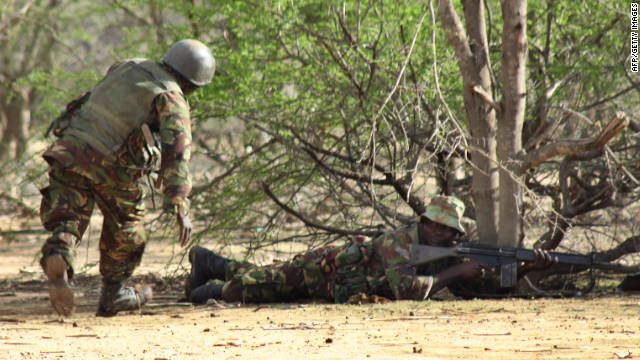 Kenyan soldiers pursue Islamic militants near Liboi, Somalia, on October 18.