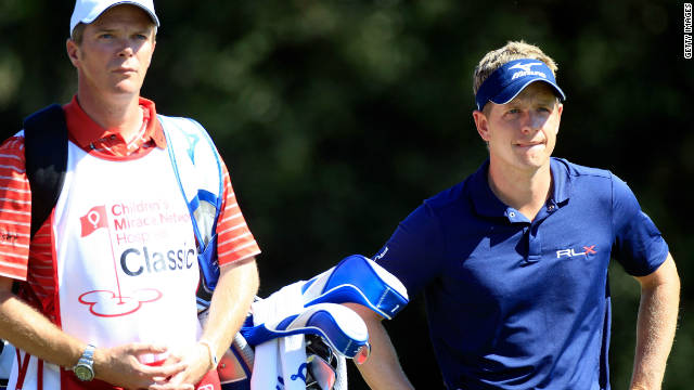 A pensive Luke Donald mulls over his options on his way to a second round 71 in Florida