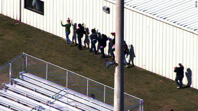 Students evacuate after a shooting Monday at Cape Fear High School in Cumberland County, North Carolina.