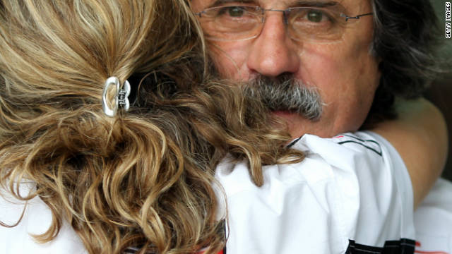 Marco's father Paolo Simoncelli is comforted after learning of his son's death.